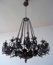 rustic dining room with large wrought iron chandelier over round module 64