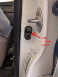go to the outside of the vehicle open your driver s door and re locate that rubber door jamb switch