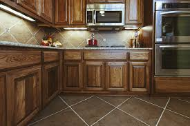 Rustic Kitchen Floors Best Beige Tile Flooring For Rustic Kitchen With Wooden Cabinet