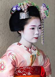 a minarai notice her bottom lip and the hair ornament with the dangling pieces of