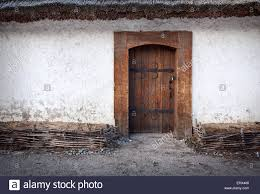 wooden old door with lock and clay wall background for design