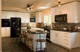 white cabinets in kitchen with black appliances. How to decorate using  countertop and backsplash with island ideas