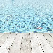 pool water background. Wood Plank Over Swimming Pool Water Background - Spa Concept Royalty-free Stock Photo I