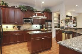 Fantastic Pot Lights Over Kitchen Island With Hanging Pot Rack Chain Also Above  Kitchen Cabinets Decorating