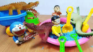 Đồ chơi Doremon - Nobita tắm cho cá sấu bằng cát động lực - YouTube