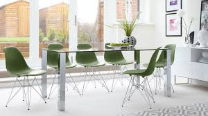 contemporary glass 6 seater dining table and eames dining chairs with metal legs
