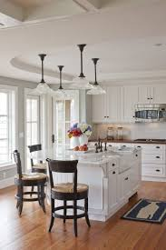 ideas for lighting over kitchen island with ceramic farmhouse sink and oil rubbed bronze bridge faucet