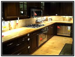 butcher block countertops dark cabinets