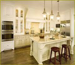 antique white kitchen cabinets with dark floors