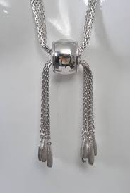 long monet necklace composed of multi strands of silver chain in the middle with a