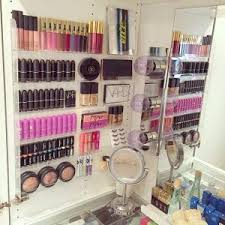 Use clear, acrylic shelving to store and organize makeup on your bathroom  wall.