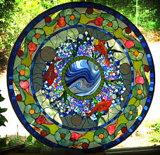 this set of stained glass pieces was created for a pool house in mclean virginia the panels are created using stained glass mosaics glued onto large clear
