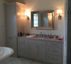 bathroom vanities chicago area. painted inset vanity with linen closet and laundry basket pull out bathroom vanities chicago area