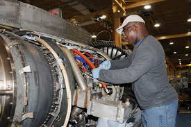 engine mechanic octavus shelton removes oil components from the gearbox of a tf34 engine used on turbine engine mechanic