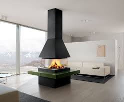 A contemporary and stylish home featuring a modern fireplace installed in  the middle of the living room