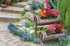 orange flower pot ideas outdoor steps with small tiered barrel flower planters