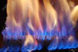 flames blue and orange natural fire in warm gas furnace
