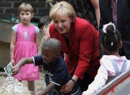 Angela merkel was born in the d.d.r., the communist portion of germany in 1954. Angela Merkel Angela Merkel Photos Chancellor Merkel And Koch Visit Kinder Garden Zimbio