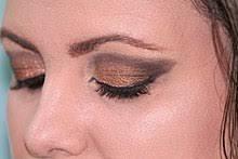 use edit eyes with heavy gold eye shadow