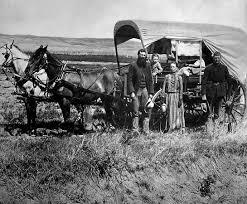 black and white covered wagon. nebraska: pioneers in a covered wagon black and white