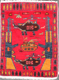 two helicopters two aks with one tank small red afghan war rug this brightly colored classic red rug is characterized by bright neon pink wool selvedges