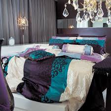 romantic bedroom for couple with damask bedding decor and crystalline chandelier