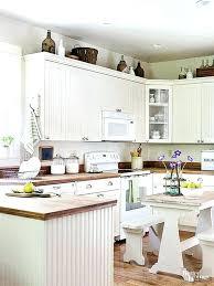 top of kitchen cabinet decor kitchen cabinet decor ideas for decorating above kitchen cabinets not sure