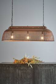 riva long antique copper perforated iron island pendant light