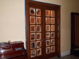 faux wood doors with glass paneling