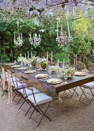 Farmhouse Dining Room Table And A Dramatic Elegant Chandelier Over - Dining room tables rustic style