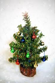Mini Christmas Tree With Lights And Decorations Miniature Christmas Tree With Tiny Ornaments Amid Falling Snow