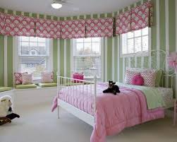 Example of a classic girl carpeted kids' bedroom design in Detroit with  multicolored walls