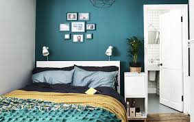 furniture for small spaces bedroom. Small Spaces; Space Planning. A Bedroom With Dark Green Wall And Colorful Bedding. Furniture For Spaces