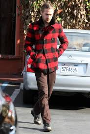 this combination of a red pea coat and dark brown suit pants oozes masculinity and refined