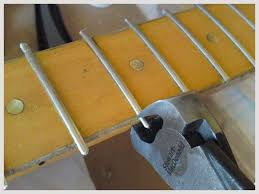 diary of a repair man gibson l6 s solidbody live4guitar the new frets now have to be level filed and crowned to give the best playing experience this is not done on most budget guitars after manufacture due to
