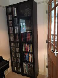 ikea billy bookcase with glass doors black brown excellent condition cube storage unit rustic floating wall
