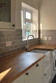 kitchen tile. belfast sink, grey subway tiles ** utility room source by stephizo kitchen tile i