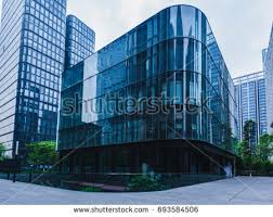 modern office exterior. Empty Footpath In Front Of Modern Office Building Exterior