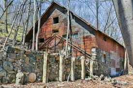 A 200-year-old stone barn on the Stewart Farm property will become the  antique dealers center.