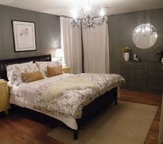 old fashioned bedroom design round mirror grey colored walls small cream rug areapattern bedcover classic lamp wooden flooring