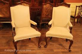 queen anne arm chairs upholstered with neutral linen fabric