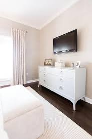 dresser with tv mount. Beautiful Dresser A Flat Panel Television Is Mounted To A Wall Covered In Tan Grasscloth  Wallpaper Above Redford House Fiona 6 Drawer Dresser This Welcoming Transitional  On With Tv Mount