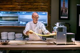 reasons for atlanta food lovers to shop in sandy springs il giallo osteria bar chef jamie adams prepares fresh pasta the restaurant s pasta is