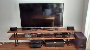 industrial pipe and wood tv stand
