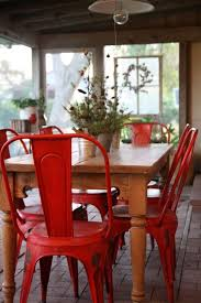 dishfunctional designs vine red painted furniture might like these metal chairs painted red for our dining table