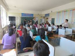 vocational english and technical education programs in the class watches students give a presentation in my english club