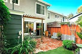 red brick patio ideas with pergola backyard