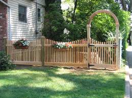 enchanting garden design with natural green grass and vinyl fence