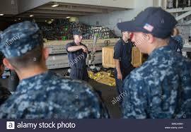 MAYPORT, Fla. (June 2, 2017) Damage Controlman 2nd Class Dustin Lucas gives  training on various damage control equipment to midshipmen in the hangar  bay of the amphibious assault ship USS Iwo Jima (