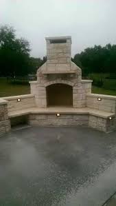 Nice Outdoor Fireplace With Benches For Seating A Wood